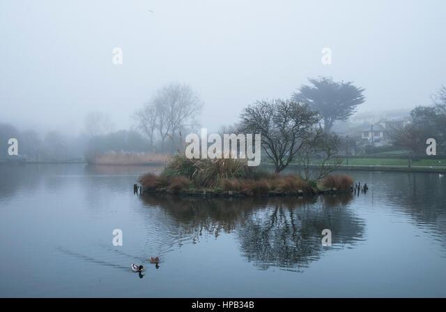 misty day Trenance Boating Lake Newquay Cornwall UK weather - Stock Image