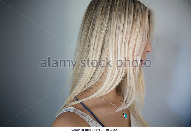 Profile blonde woman with obscured face - Stock Image