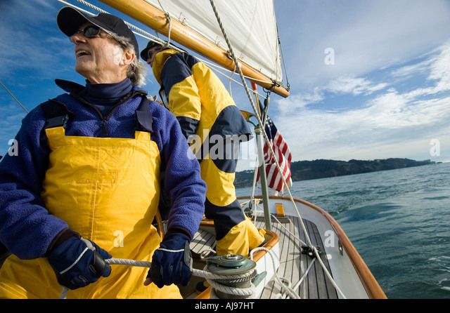 Two men on a sailing yacht. - Stock Image
