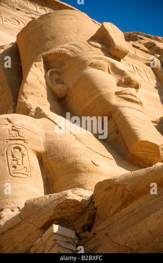 Gigantic stone relief of Ramses II on the massive temple, Abu Simbel, Egypt, Africa - Stock Image