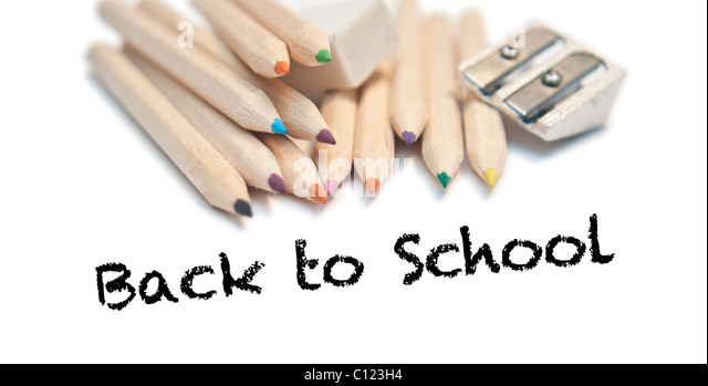 Back to school text with color pencils, rubber and sharpener on white background - Stock Image