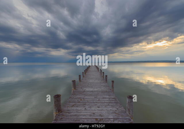 Wooden Jetty at Sunset at Weiden, Lake Neusiedl, Burgenland, Austria - Stock Image