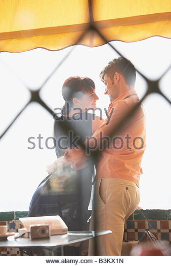 Couple hugging in cafe - Stock-Bilder