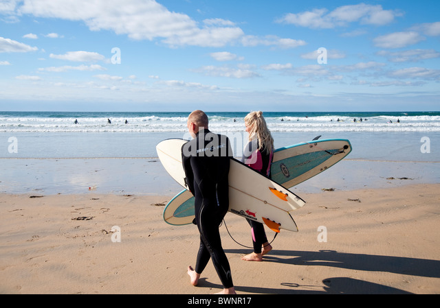 Surfers Fistral Beach, Newquay Cornwall UK - Stock Image