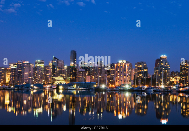 Evening skyline Coal Harbour Vancouver Canada - Stock Image