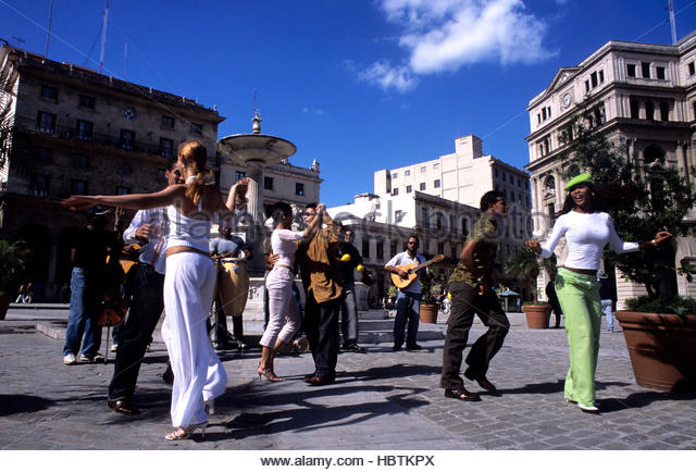 Cubans dancing in the street, Havana, Cuba. - Stock Image