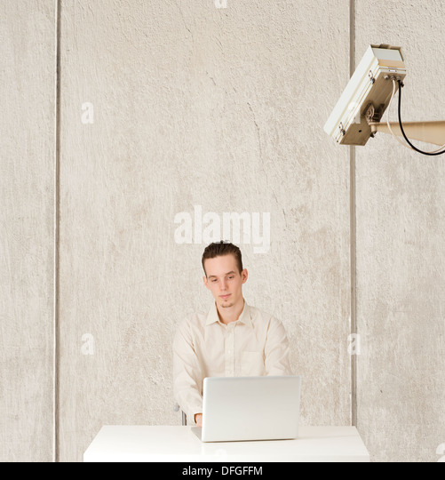 Conceptual image of internet privacy and computer surveillance, man being watched - Stock Image