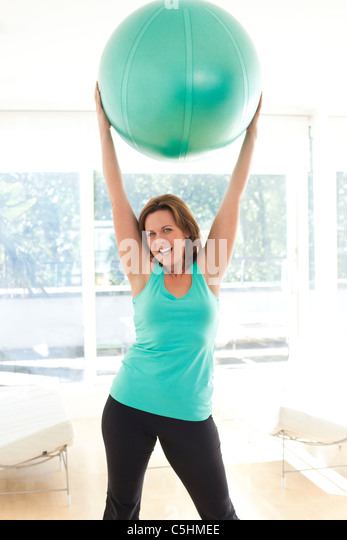 Woman exercising - Stock Image