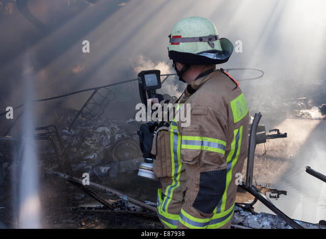 firefighter at work loesch stock photos firefighter at work loesch stock images alamy. Black Bedroom Furniture Sets. Home Design Ideas