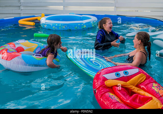Above ground swimming pool stock photos above ground for Kids swimming pool garden