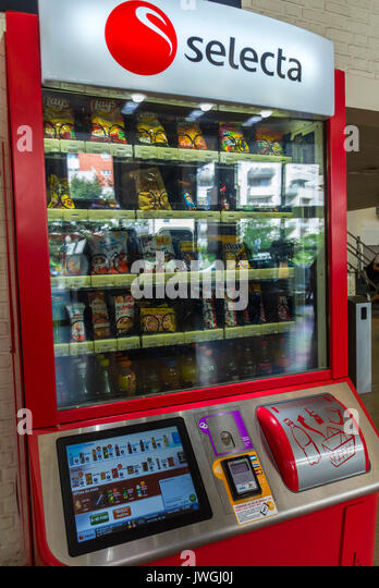 Detail, Fast Food Candy, Drinks, Vending Machine in Bercy rain Station Waiting Room - Stock Image