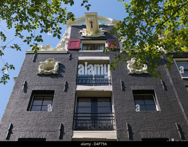 Amsterdam, Netherlands, historic facade on the Singel corner Beulingstraat - Stock Image