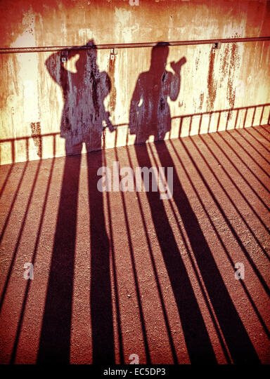 Concept picture of people with cameras shadows. - Stock-Bilder
