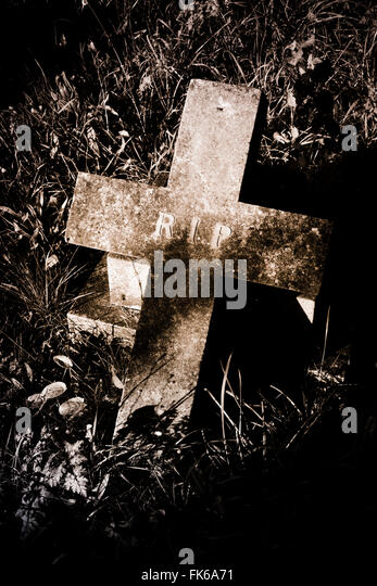 Headstone in graveyard. - Stock Image