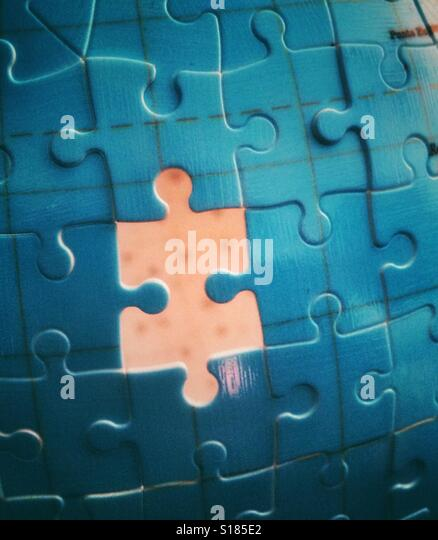 A missing piece of a jigsaw - Stock Image