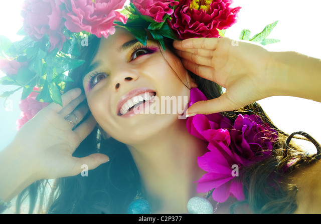 Beautiful woman with bright flowers in good mood - Stock Image