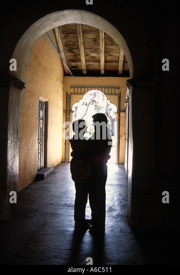 Silhouette of senior couple in archway door of Spanish mission in California USA - Stock Image