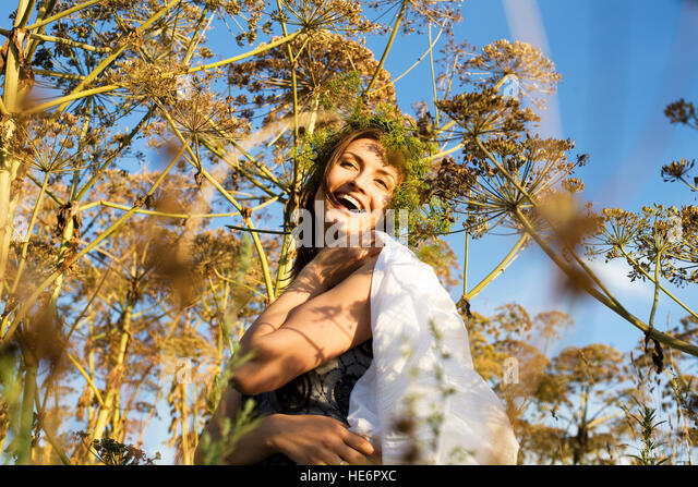 young cute summer girl on green grass outside relaxing happy smiling close up, lifestyle people concept - Stock Image