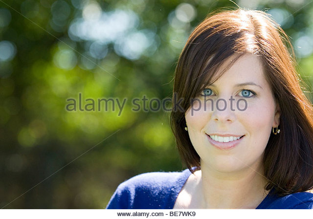 Portrait of a woman outdoors - Stock Image