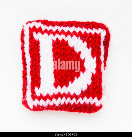 Knitted letter D woollen lettering. - Stock Image
