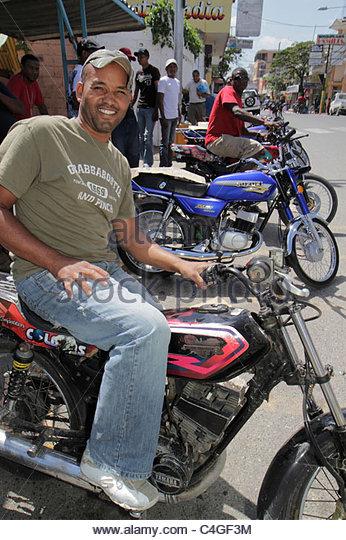 Santo Domingo Dominican Republic Bajos de Haina motorcycle taxi motoconcho public transportation alternative business - Stock Image