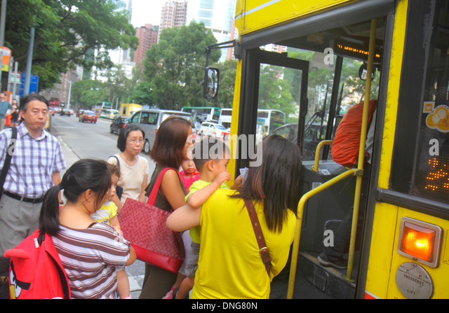 Hong Kong China Island Hennessy Road bus public transportation passengers boarding Asian woman mother children - Stock Image