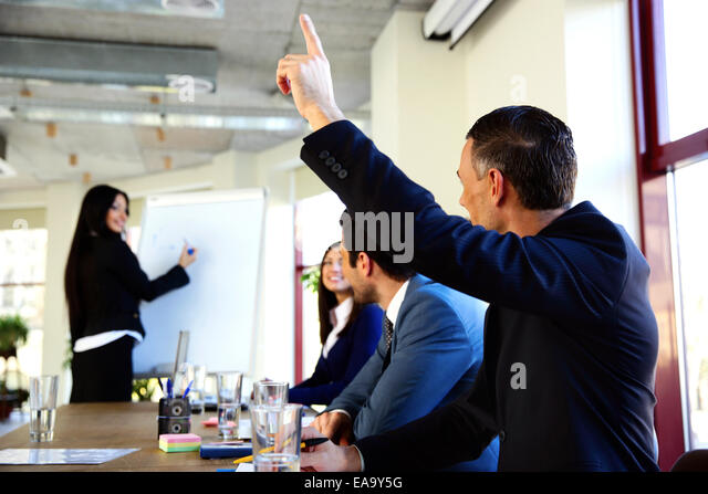 Happy businesspeople working at the office together - Stock Image