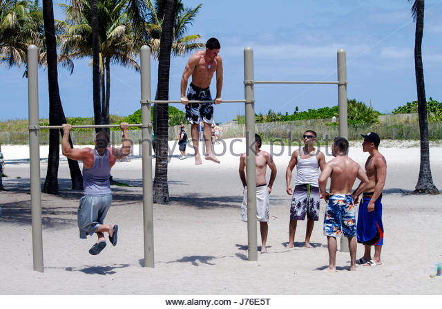 Miami Beach Florida Lummus Park exercise workout pull-up bar dips muscles strength fitness man men - Stock Image