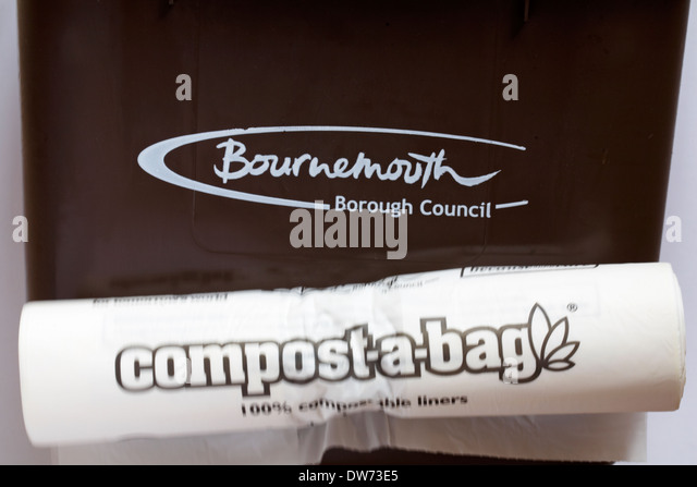 Bournemouth Borough Council food waste bin with compost-a-bag 100% compostable liners - Stock Image
