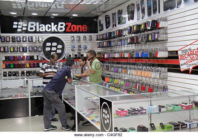 Santo Domingo Dominican Republic Ciudad Colonial Calle el Conde Peatonal pedestrian mall BlackBZone counter smartphone - Stock Image