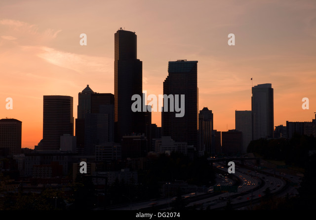 WASHINGTON - Silhouette of the highrises in downtown Seattle and Interstate 5 at sunset. - Stock Image