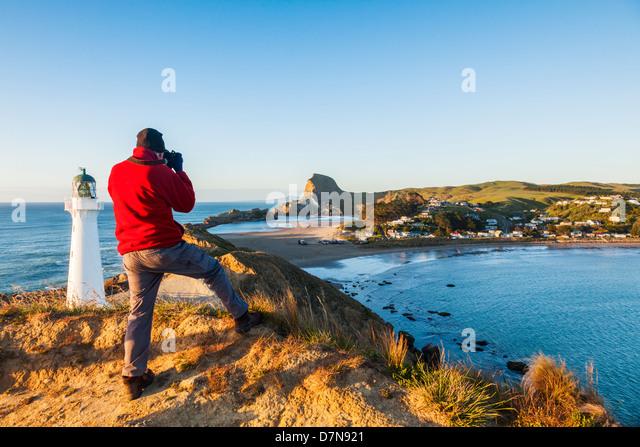 Photographer at Castlepoint Lighthouse, Wairarapa, New Zealand. - Stock Image