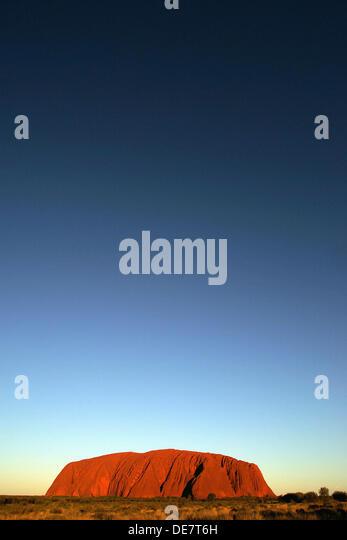 Sunset over Uluru Ayres Rock in Northern Territory in Australia - Stock Image