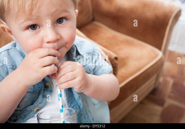 Baby boy drinking milk - Stock Image