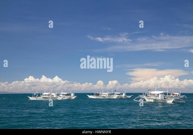 Philippines, Luzon, Sorsogon Province, Donsol, Whale shark interaction boat recovering tourist from the sea - Stock-Bilder