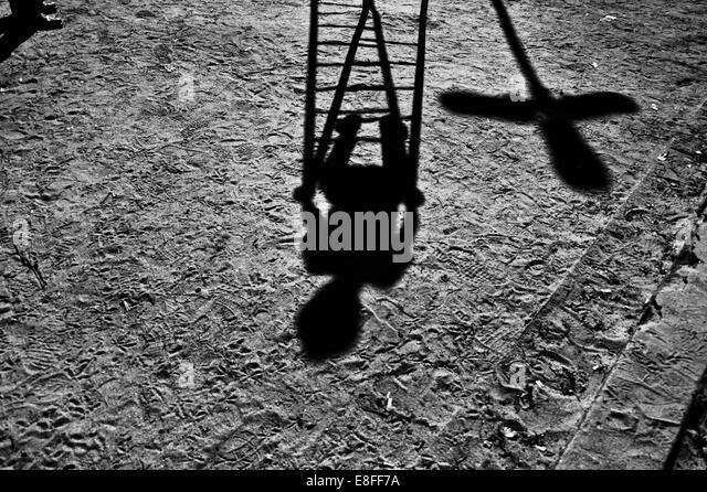 Brazil, Sao Paulo, Shadow of boy in playground - Stock Image