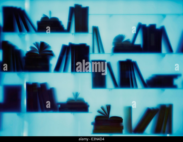 Group of books silhouetted - Stock Image