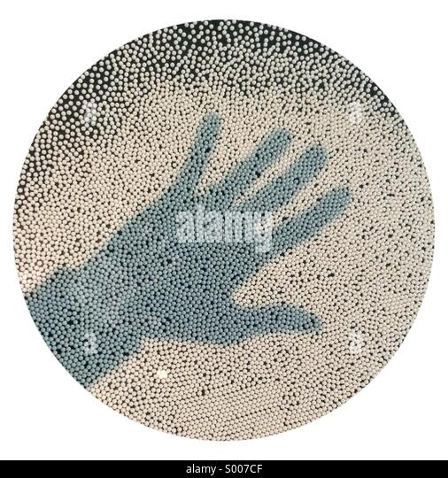 Shadow of hand in circle - Stock Image