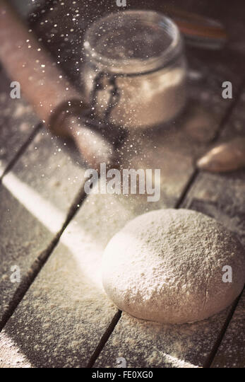 Freshly made dough on a farmhouse table. - Stock Image