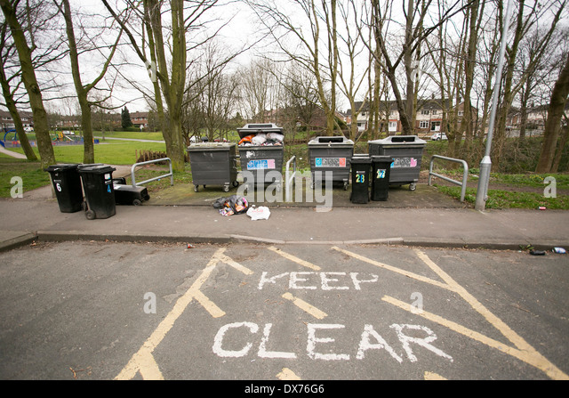 Rubbish overflows from bins - Stock Image