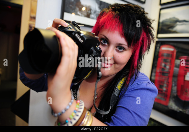 Photography student with camera at sixth form further education college - Stock Image