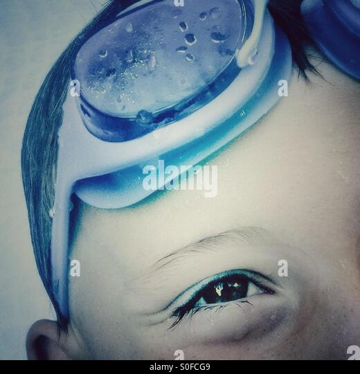 Close up of a kid with goggles - Stock Image