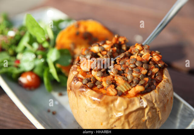 Warming and healthy autumn or fall lunchtime food, butternut squash, lentils and salad, in England, UK - Stock Image