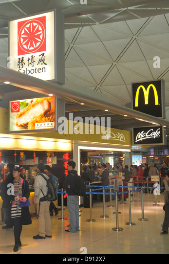Hong Kong China International Airport HKG terminal concourse gate area inside interior food court Saboten McDonald's - Stock Image