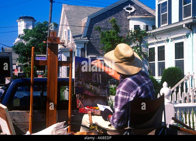 Artist painting a canvas along Commerce Street Provincetown Cape Cod MA - Stock-Bilder