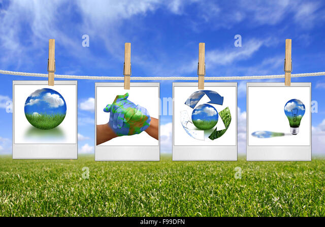 Green Energy Solution Images Hanging on a Rope - Stock Image