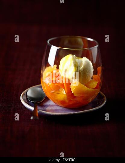 Carrot and orange salad with vanilla ice cream - Stock Image