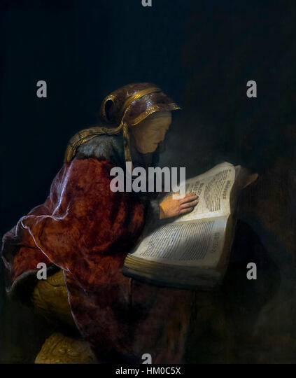 Old Woman Reading, probably the Prophetess Hannah, by Rembrandt, 1631, oil on panel, Rijksmuseum, Amsterdam, Netherlands, - Stock Image