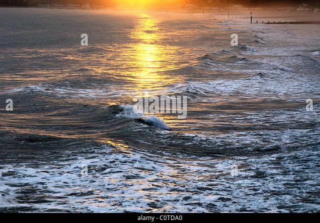 Winter sunlight on waves,Bournemouth Dorset England UK - Stock Image