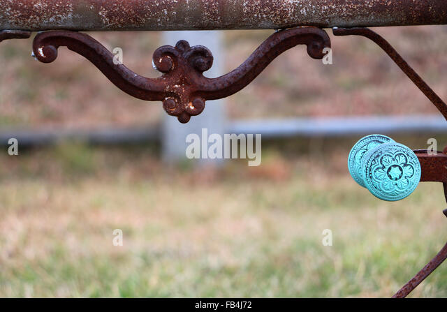 19th Century iron fence with oxidized copper handle found in a Nantucket, Massachusetts cemetery. - Stock Image